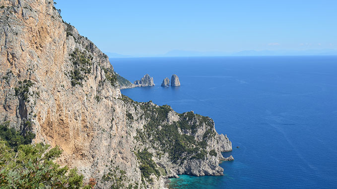 The beautiful view of the Faraglioni rocks in Capri