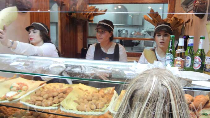 Our guide will take you to authentic deli shops and expalin you the art and histori of the area visited